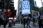 NEW YORK, NY - APRIL 18: People pass walk by the Nasdaq building as the screen shows the logo of the video-conferencing software company Zoom after the opening bell ceremony on April 18, 2019 in New York City. The video-conferencing software company announced it's IPO priced at $36 per share, at an estimated value of $9.2 billion. (Photo by Kena Betancur/Getty Images)