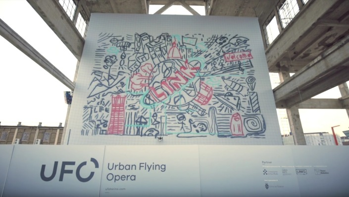 This drone swarm spray painted a jumbo-size graffiti mural