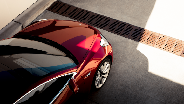Tesla model 3 red overhead