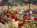 Robotic arms on duty in a car factory.