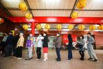 Voters wait in line to cast their vote at a polling station during the presidential election in Taipei, Taiwan, on Saturday, Jan. 16, 2016. Photographer: Maurice Tsai/Bloomberg via Getty Images