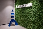 Signage for Atlassian Corp. is displayed in the enterprise software company's Global R&D Center in Bengaluru, India, on Wednesday, July 3, 2019. Atlassian Co-founder and Chief Executive Officer Cannon-Brookes has said the firm will get all its power from renewable sources by 2025. Photographer: Karen Dias/Bloomberg via Getty Images
