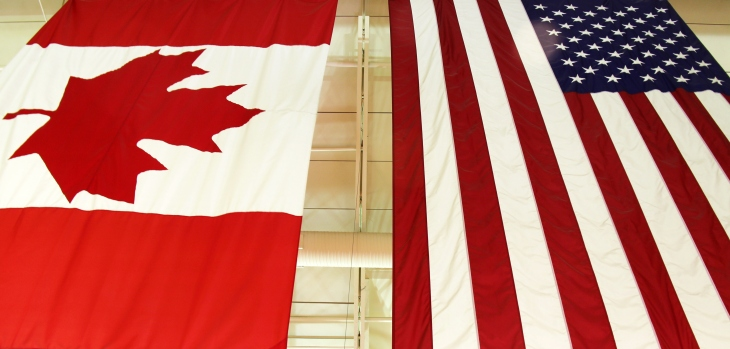 United States National flag and Canadian flag ( Maple Leaf) hang side by side