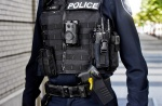 A police officer with body camera and Taser.