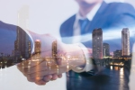 Double exposure concept. Investor business handshake with city night. Businessman shaking hands using as business partnership success concept, Teamwork concept, Investment, Growth