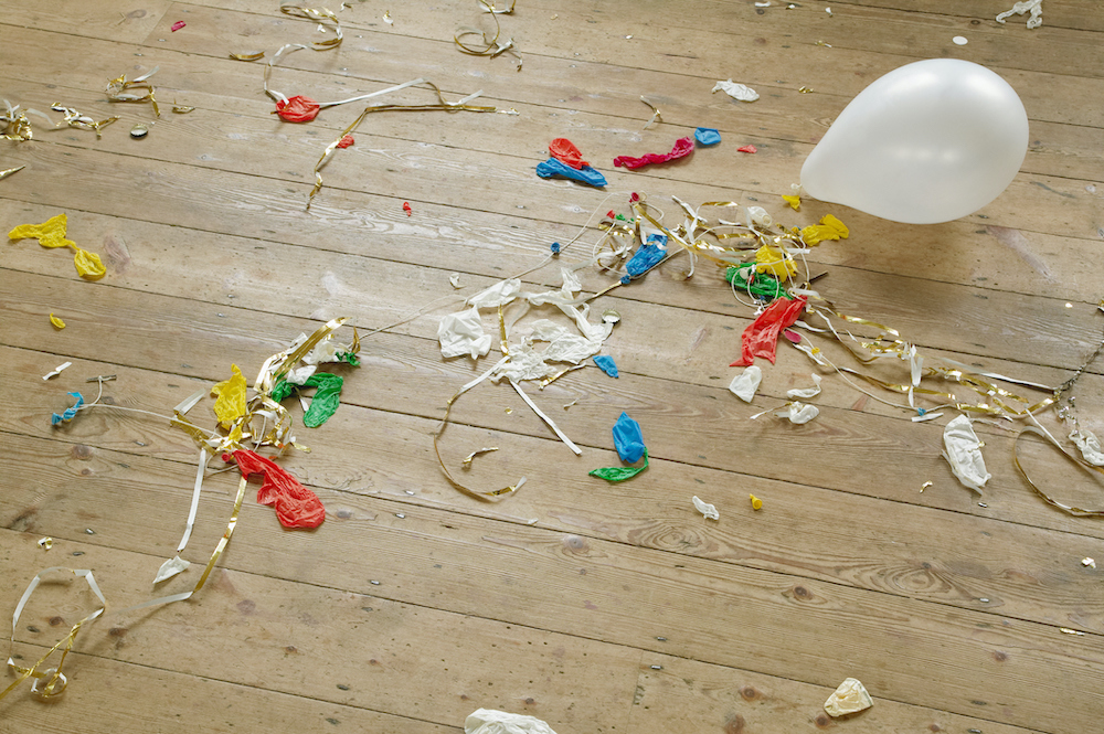 Pop balloons and party streamers on wooden floors
