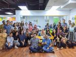 A group photo of Indonesian insurtech startup PasarPolis' team