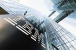 The IBM logo on the entrance to the Highlight Towers in Munich, Germany, 6 March 2017. The IT giant IBM operates its worldwide headquarters for the Watson IoT (Internet of Things) department. Photo: Matthias Balk/dpa | usage worldwide (Photo by Matthias Balk/picture alliance via Getty Images)