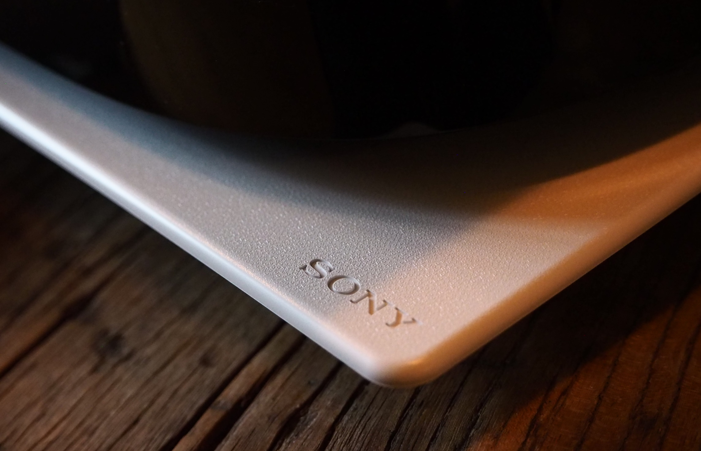 Close up of the Sony logo on the PS5 and tiny characters making a pattern.
