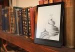 A Boox Poke 3 e-reader on a bookshelf.