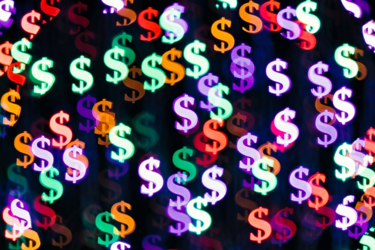 Multi Colored Bling Bling Dollar Sign Shape Bokeh Backdrop on Dark Background, Finance Concept.