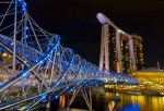 An evening view of Helix Bridge and Marina Bay Sands in Singapore