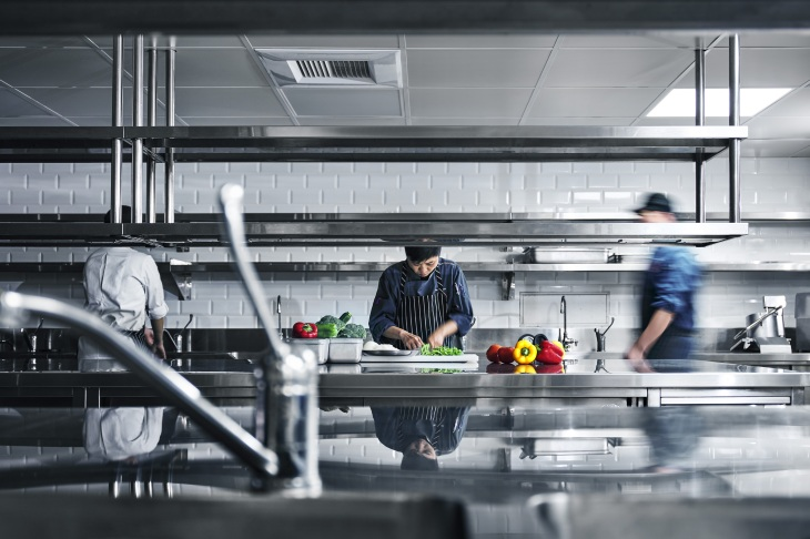 A photo from cloud kitchen startup JustKitchen, showing cooks prepping meals for delivery