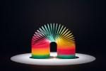 Spotlit Multi Colored Coil Toy in the Dark.