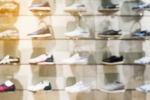 Shoes on shelves in shoes store