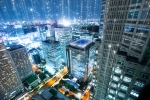 Smart buildings communicating data in a city.