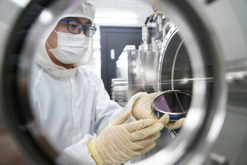 BEIJING, CHINA - MAY 26: A researcher deals with a wafer arrayed with carbon nanotubes (CNT) at a laboratory on May 26, 2020 in Beijing, China. (Photo by VCG/VCG via Getty Images)