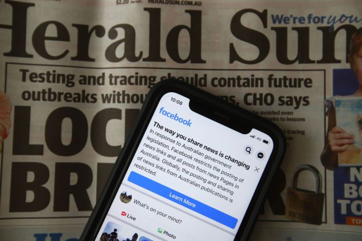 a message is seen on facebook mobile, on february 18, 2021 in melbourne, australia. facebook has banned publishers and users in australia from posting and sharing news content as the australian government prepares to pass laws that will require social media companies to pay news publishers for sharing or using content on their platforms.