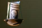 Dollar in a bowl of balance.