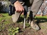 Person using Yard Stick measurement tool in soil