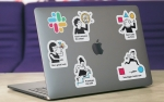 laptop with five stickers representing product principles