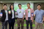 From left to right: Advotics' co-founder and CEO Boris Sanjaya, Head of Growth Venny Septiani, co-founder and CTO Hendi Chandi, co-founder and CPO Jeffry Tani, and a representative from Danone, holding smartphones displaying Advotics' apps