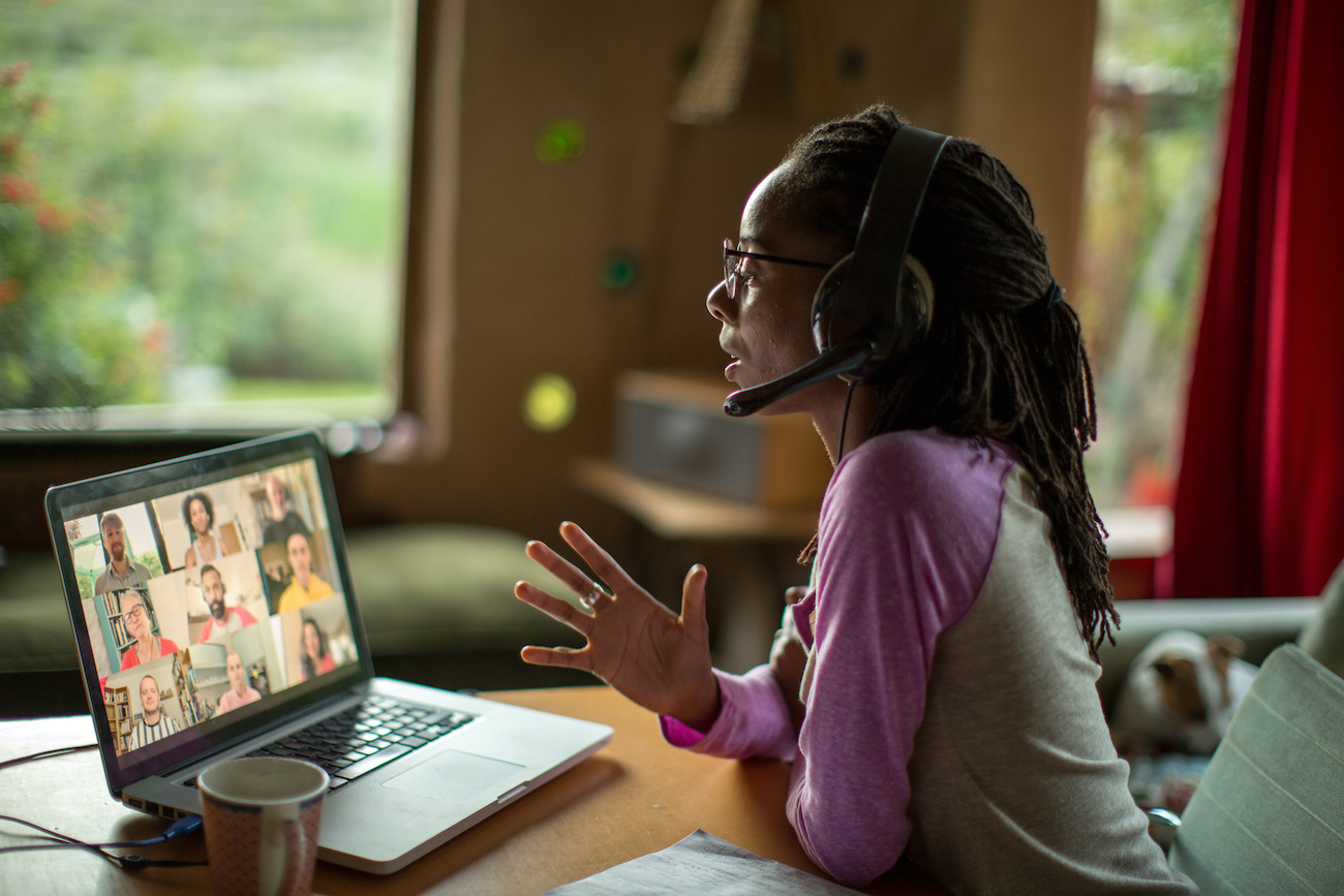 An Afro-Caribbean woman works from home during the COVID-19 lockdown