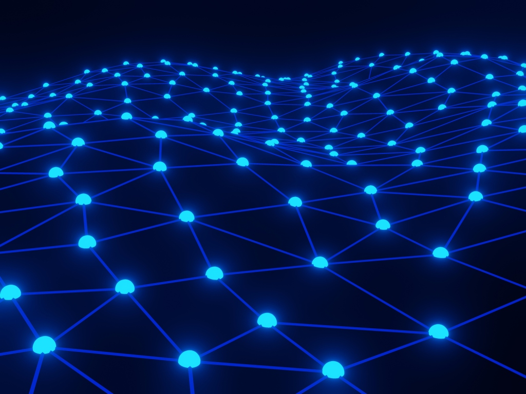 Dots representing blockchain nodes connected together in network on a black background.