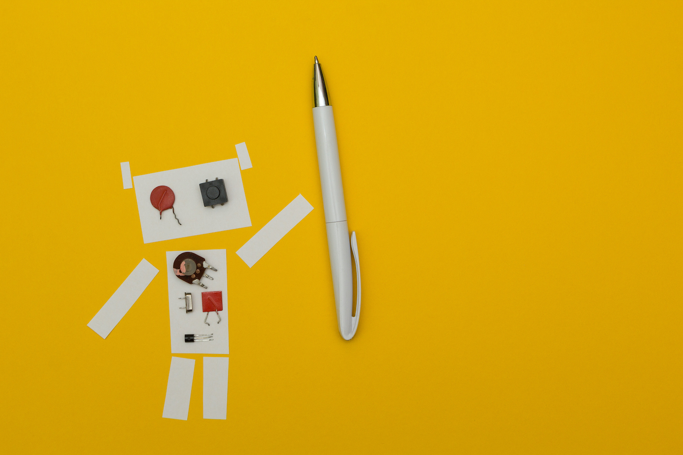 Paper robot holding pen, space for text