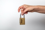 Padlock in woman's hand. Data, information, property and security on the Internet concept. White background