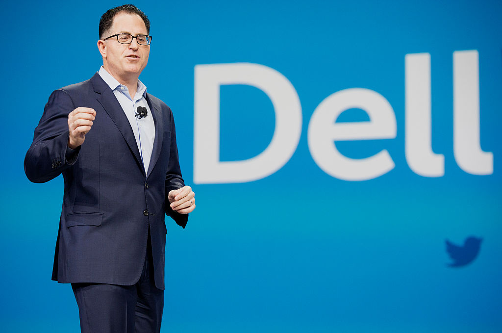 Michael Dell, founder and chief executive officer of Dell Inc., speaks during the 2015 Dell World Conference in Austin, Texas, U.S., on Wednesday, Oct. 21, 2015. Dell said trimming debt for the massive deal to combine his namesake company with EMC Corp. should progress relatively quickly in the next couple of years. Photographer: Matthew Busch/Bloomberg via Getty Images