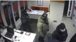 Masked men enter the Imaguru startup hub in Minsk