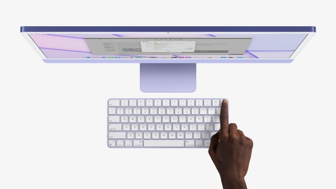 Apple Touch ID on magic keyboard in front of 2021 iMac