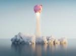 #D render of a pink piggy bank taking off like a rocket