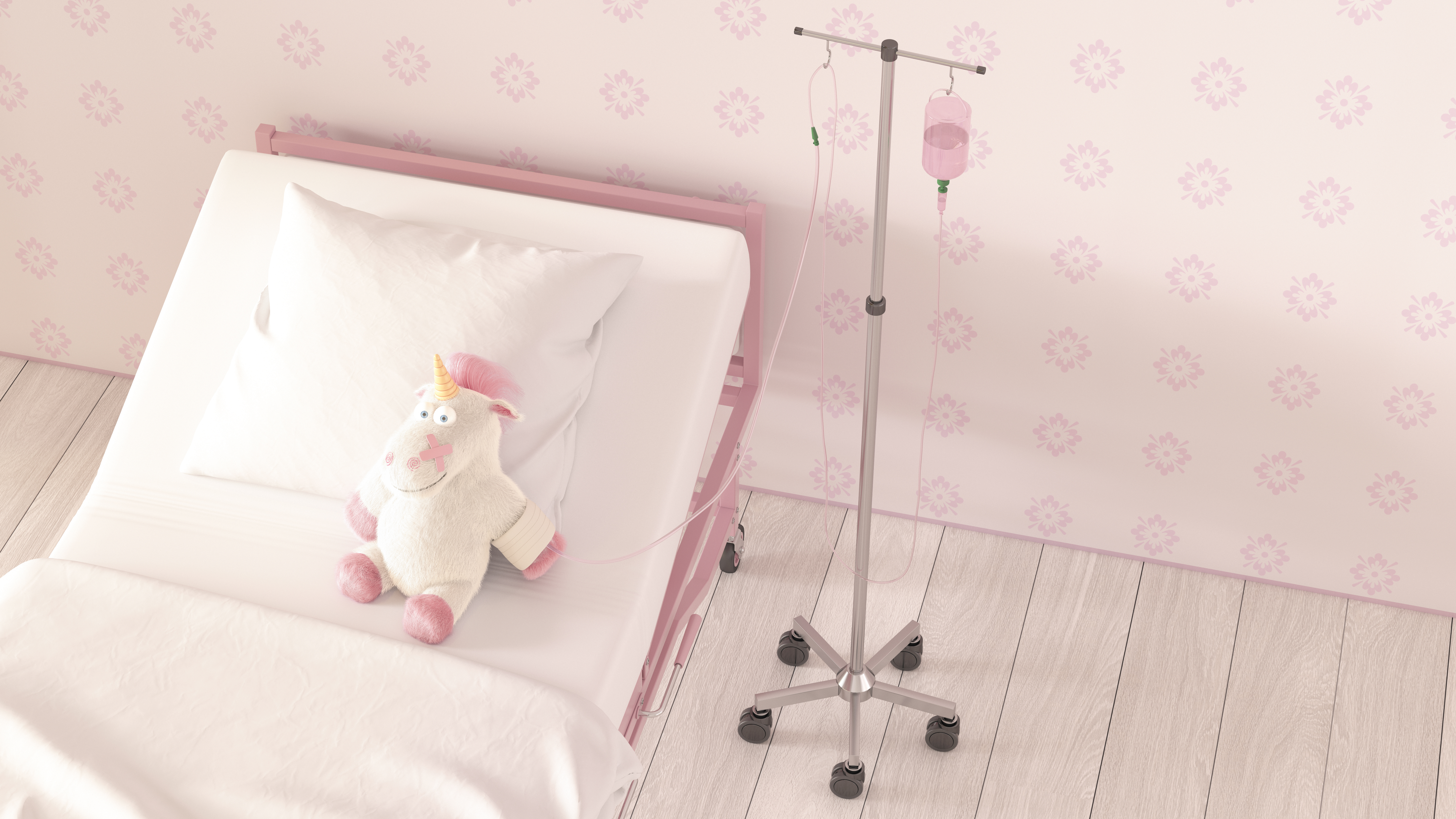 Image of a stuffed unicorn sitting in a hospital bed hooked up to an IV
