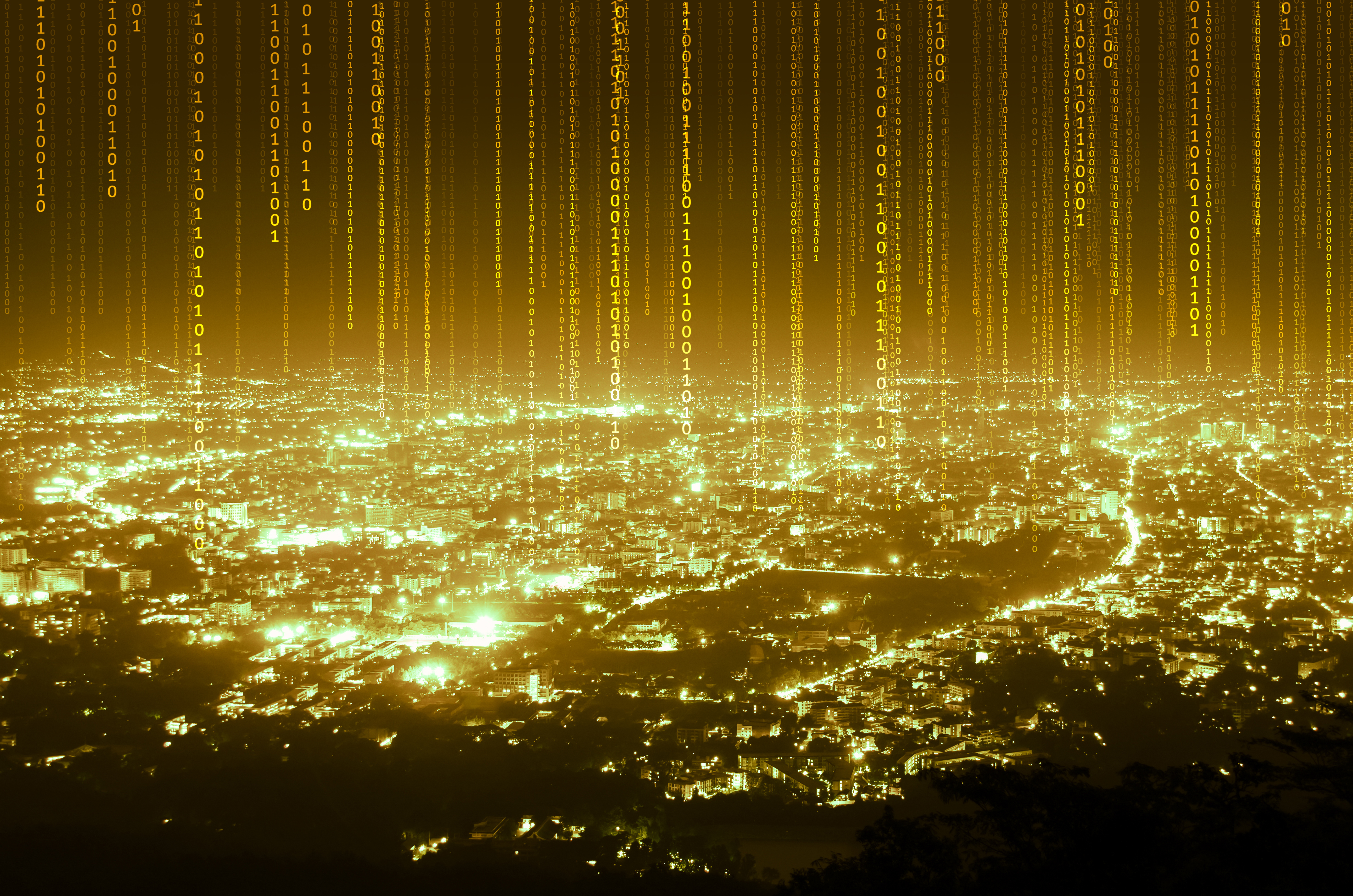 Illuminated gold code streaming from a cityscape.