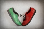 A red and a green shoe tied together