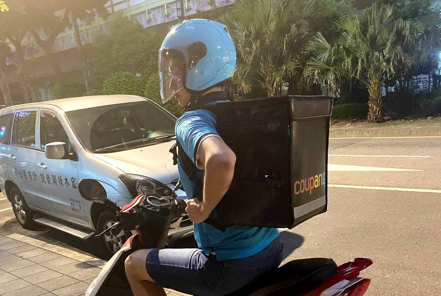 One of Coupang's delivery drivers on a scooter in Taipei, Taiwan