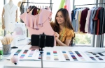 Fashion vlogger presenting clothes on an online live shopping platform