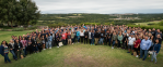 Articulate employee group picture on a mountain top overlooking a green valley
