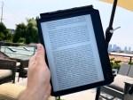 The Kobo Elipsa e-reader being held outside.