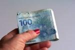 Female hand holding brazilian money (Real/Reais)