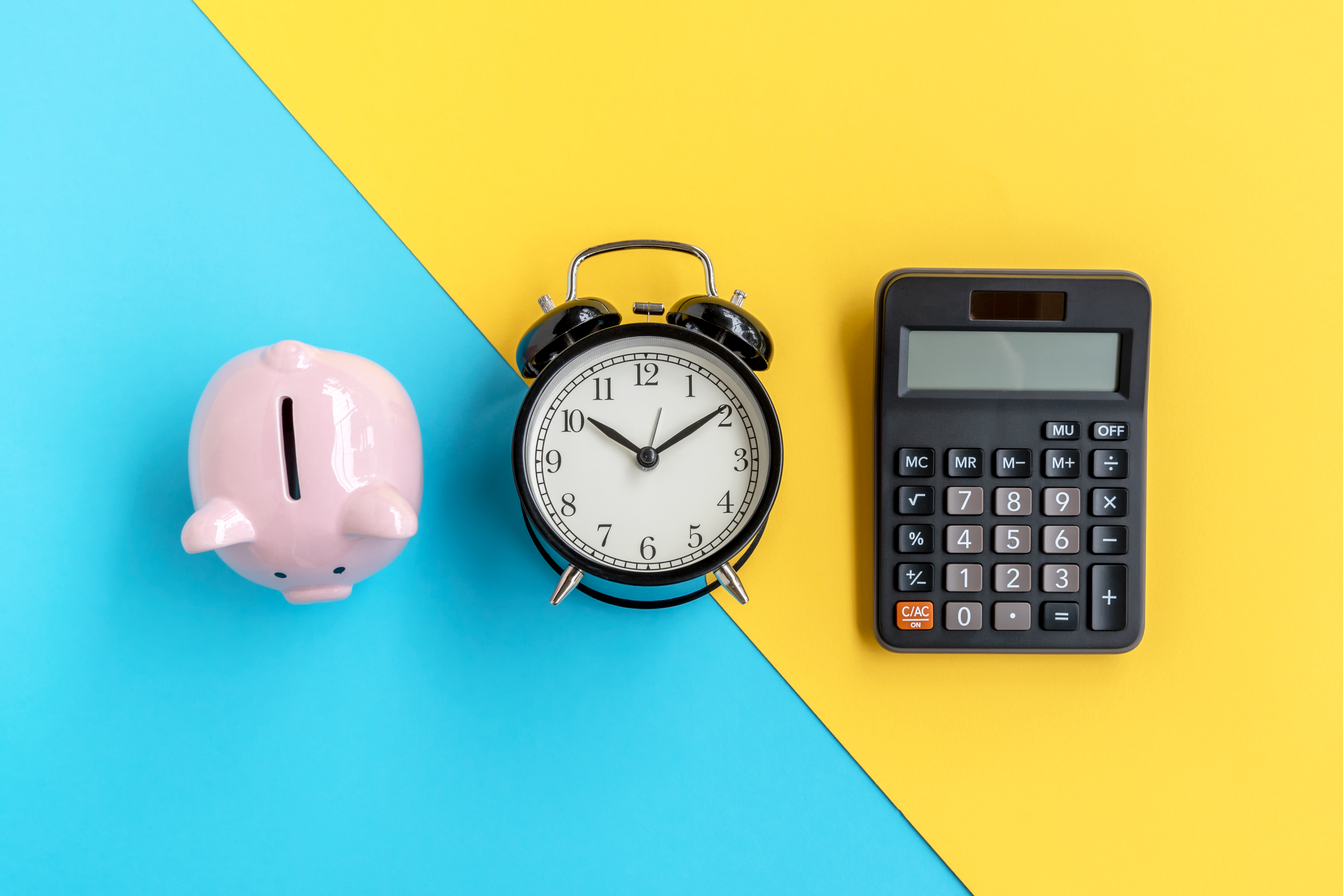 Image of a piggy bank, clock, and calculator on blue and yellow background to represent financial advice.