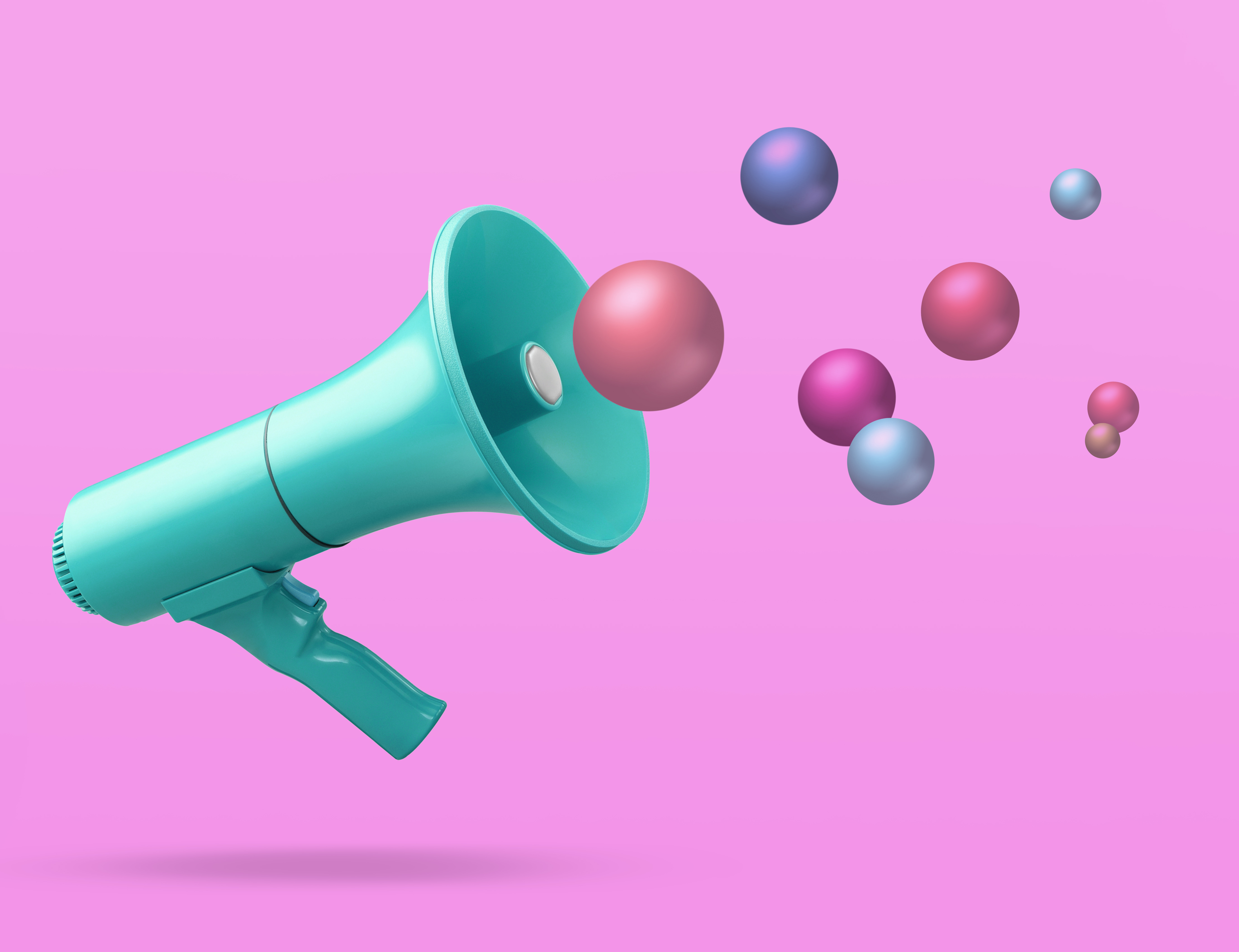 Image of a megaphone on a pink background with colorful balls in the air to represent marketing.