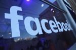 Facebook logo on glass