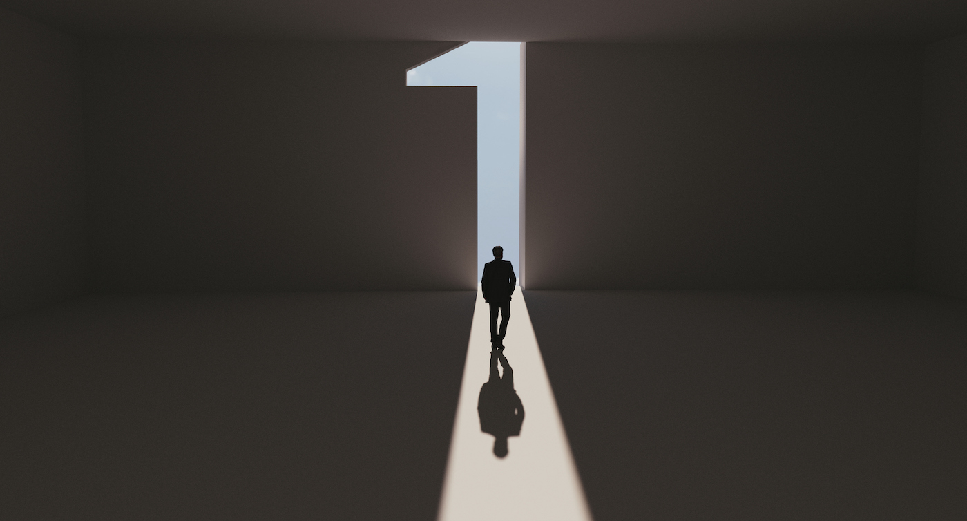 Man walks towards a big number one symbol that lights up. He is surrounded by darkness, but walks on a path of sunshine reaching first place. Note: Digitally generated image.