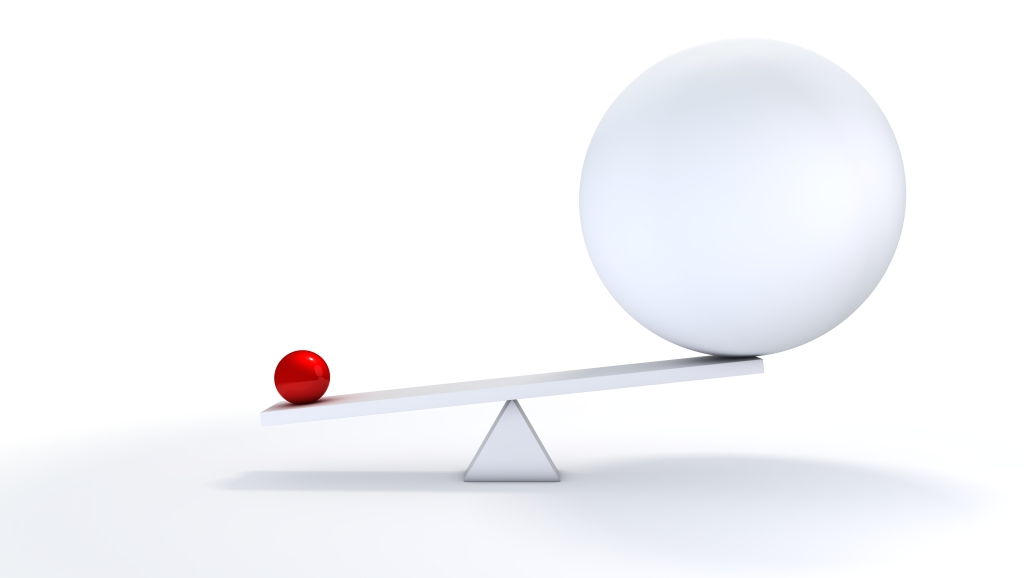 Image of a small ball and a large ball on a seesaw to represent anticompetitive business practices.