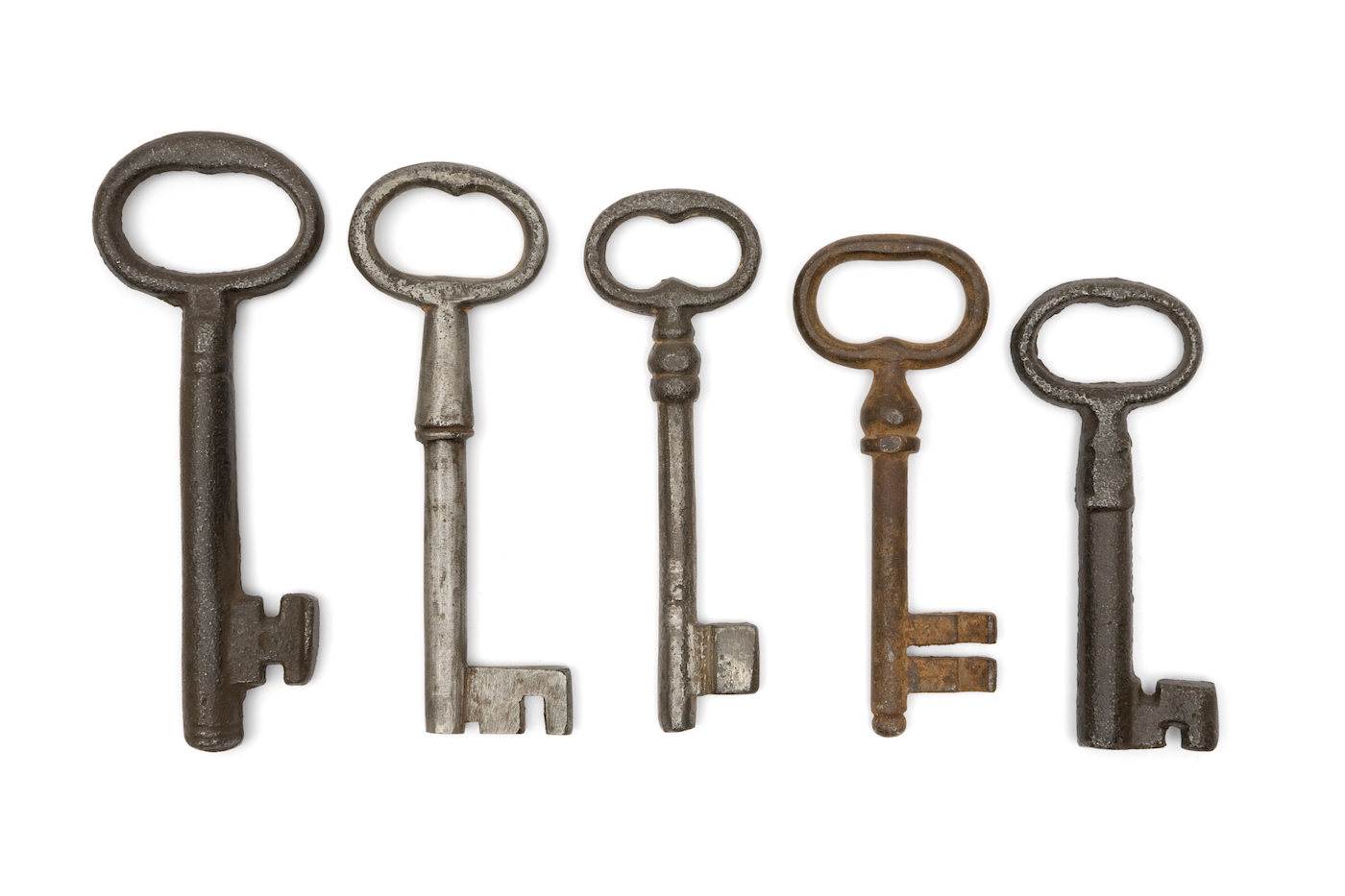 Rusty old keys isolated on a white background.