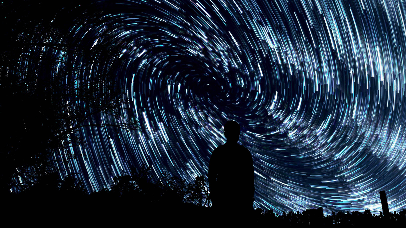 long exposure stars with silhouetted figure